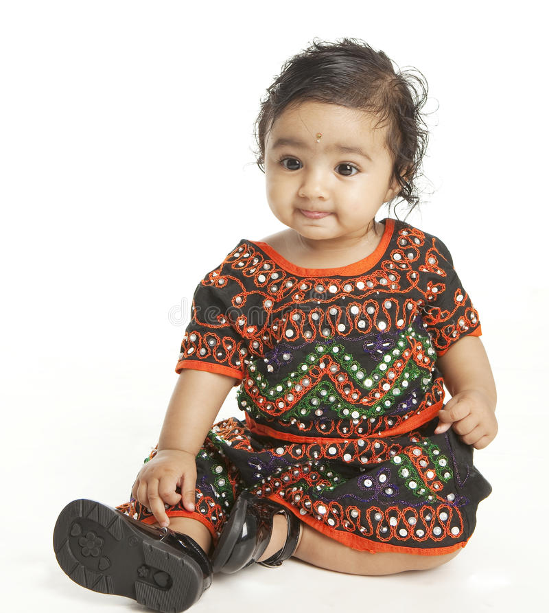 Indian Baby Girl in Traditional Attire. Portrait of an Asian Indian Baby Girl in Traditional Attire on White stock images