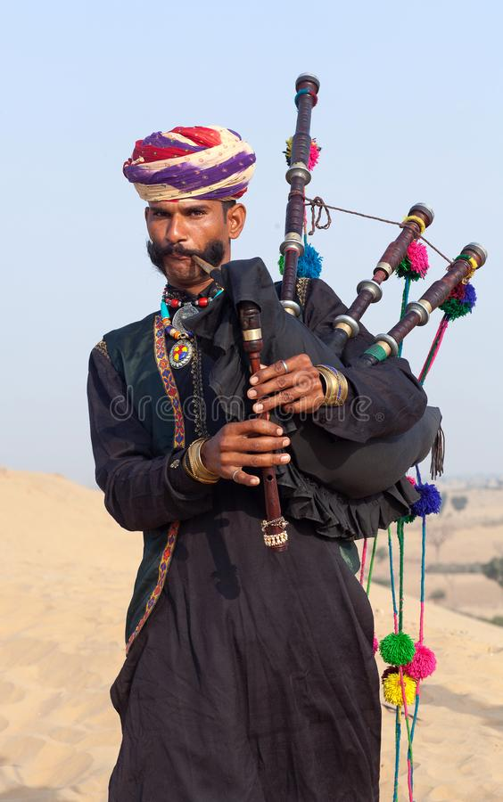 Indian bagpiper in national clothes performing during Camel festival in Thar desert in Rajasthan, India stock photos