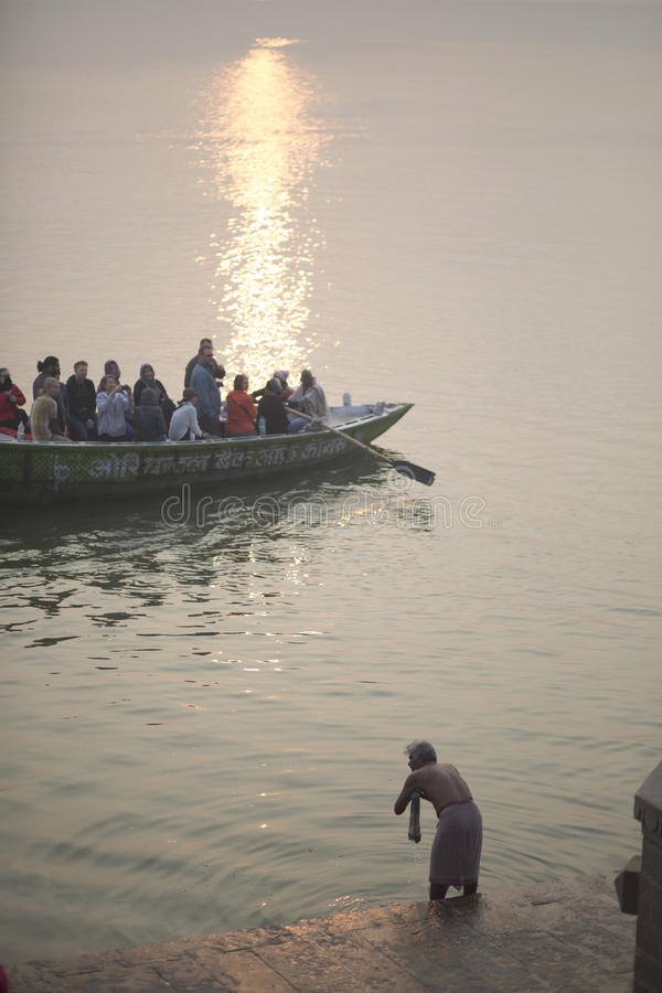 Indian bathes in Ganges stock photos