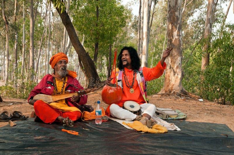 Indian baul folk singers. SHANTINIKETAN, INDIA - DECEMBER 22: Traditional baul folk singers perform during the annual Poush Mela fair on December 22, 2012 in stock photo