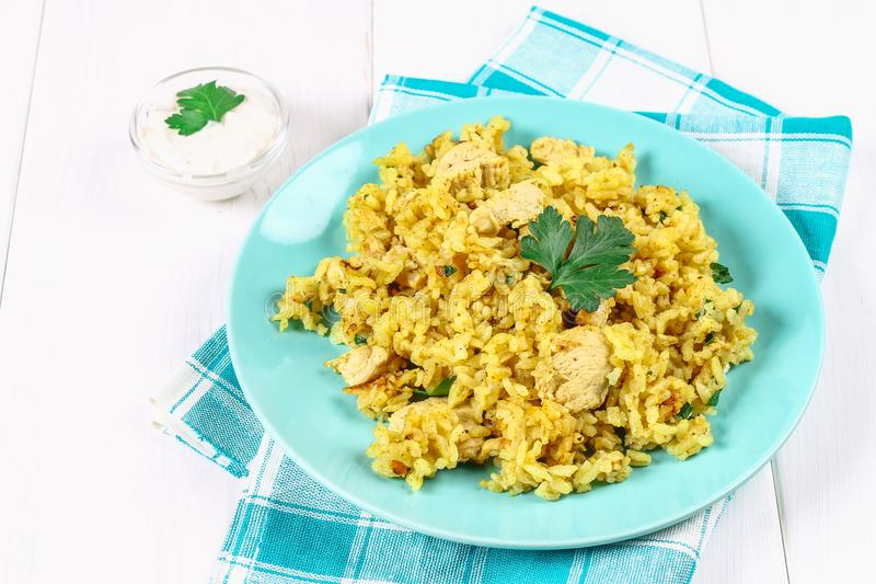 Indian biryani with chicken, yogurt and spices in a plate on a wooden table. New Year's, Christmas dish. Indian biryani with chicken, yogurt and spices in a royalty free stock photography