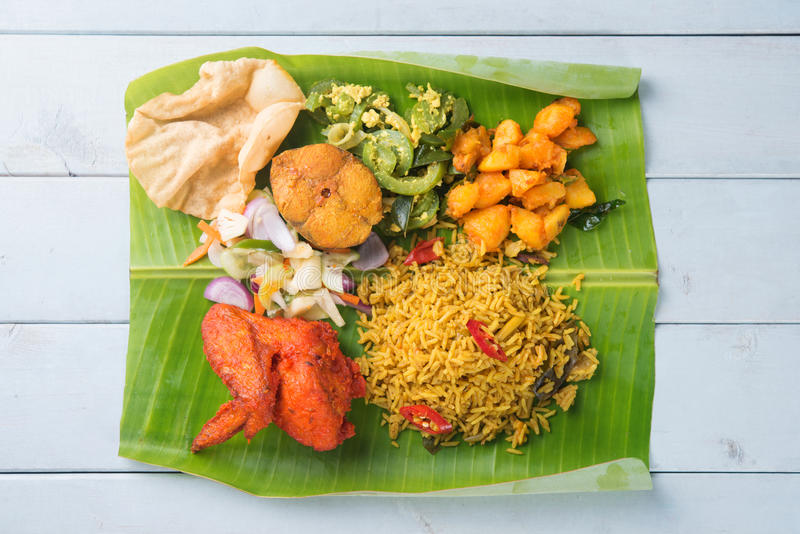 Indian biryani mixed rice. Overhead view of full length Indian biryani mixed rice on wooden dining table stock photo