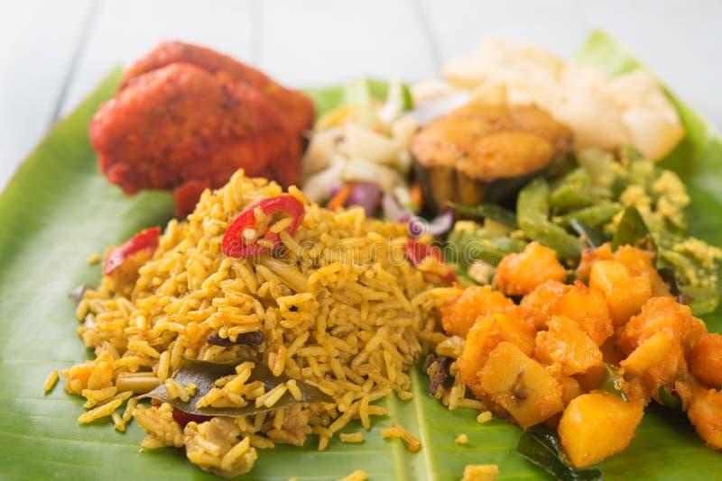 Indian biryani rice on banana leaf. Close up traditional Indian biryani rice on banana leaf royalty free stock photos