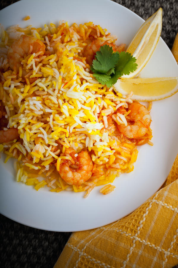 Indian Biryani with Shrimp. And lemon on a table royalty free stock photo