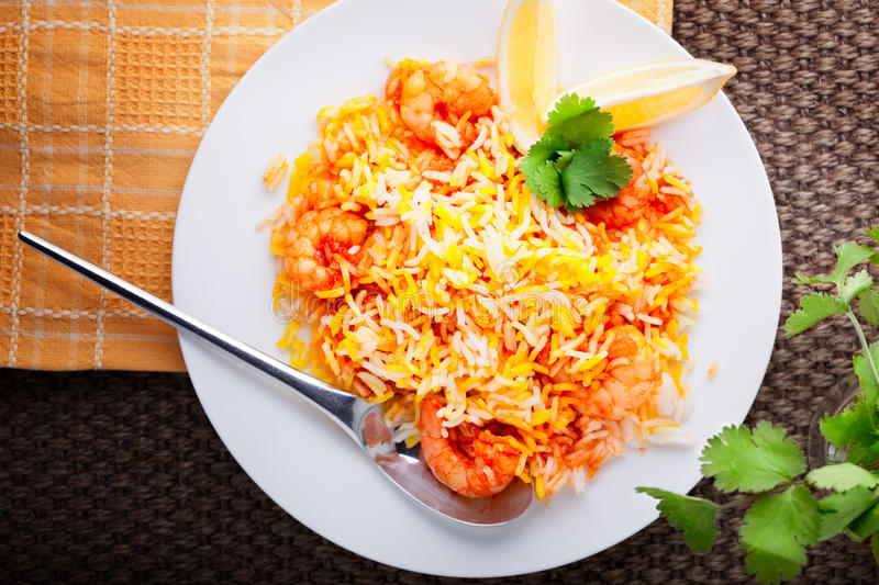 Indian Biryani with Shrimp. And lemon on a table royalty free stock photos