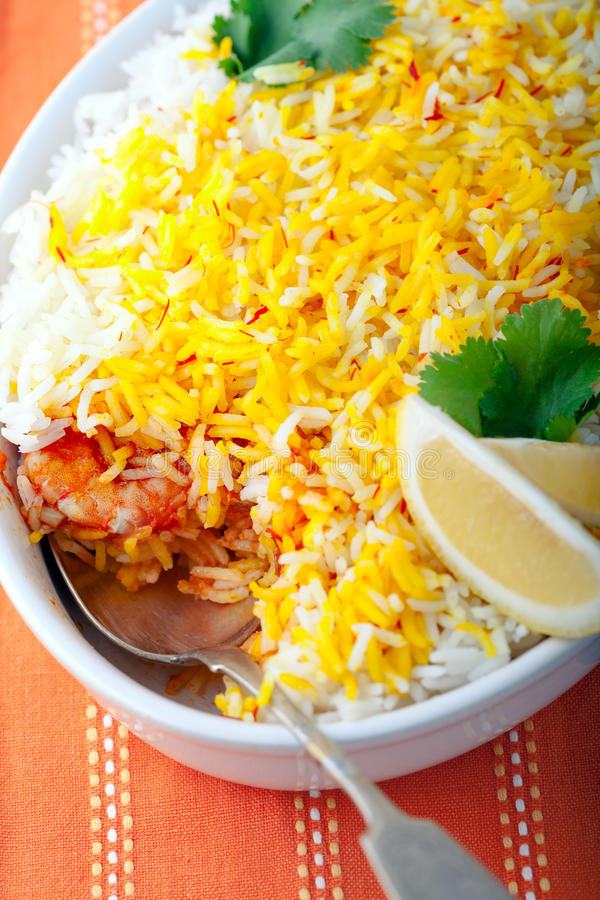 Indian Biryani with Shrimp. And lime on a white plate stock photography