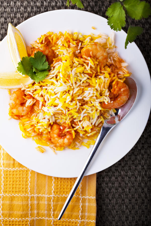 Indian Biryani with Shrimp. On a white plate stock image