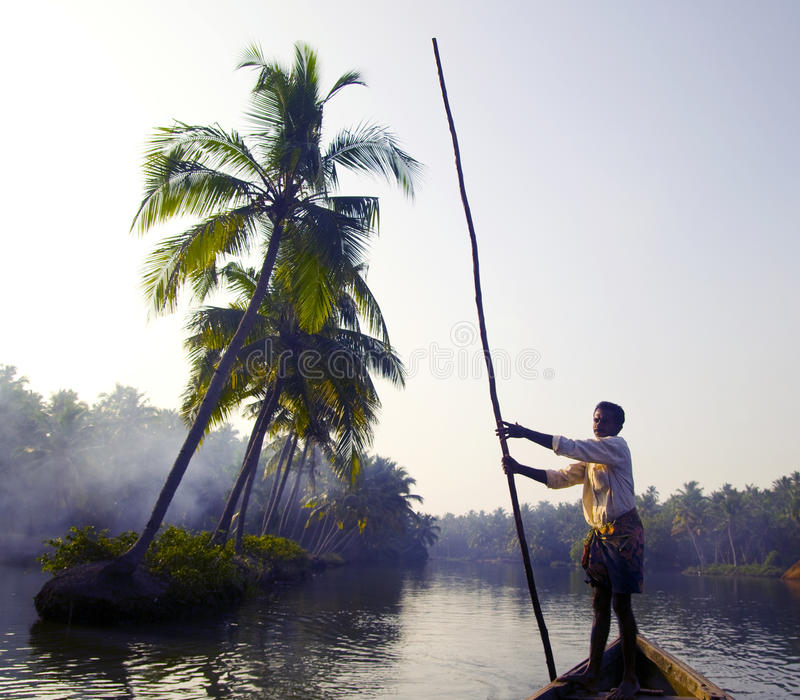 Indian Boatman and Traditional Boat.  stock photography