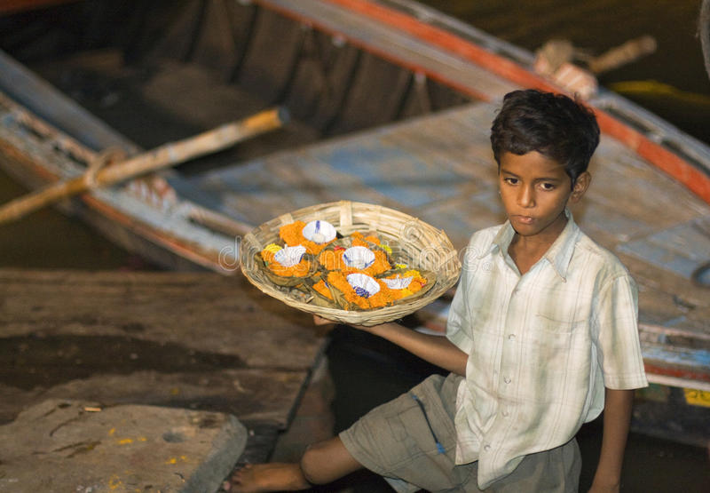 Download Varanasi, India, Indian Boy Selling Aarti Editorial Photography - Image: 23124157