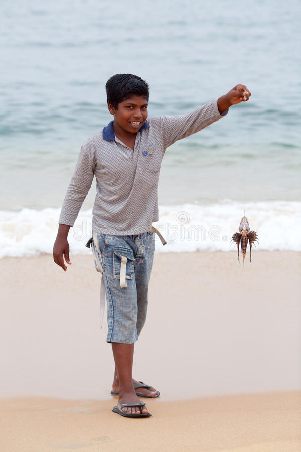 Indian boy with poison lionfish royalty free stock photo