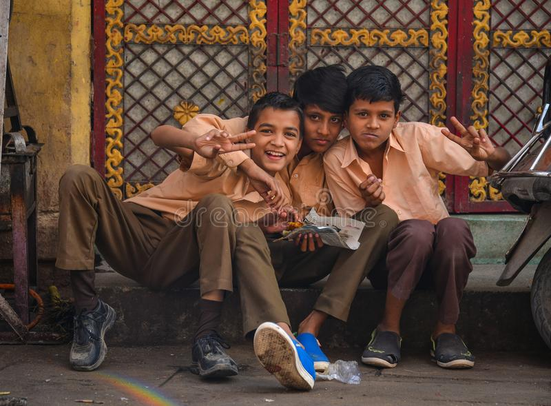 Indian boys sitting on street in Jodhpur, India royalty free stock photo