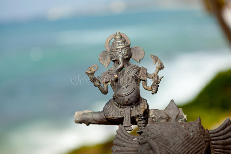Indian brass sculpture at ocean background. Kerala India royalty free stock photography