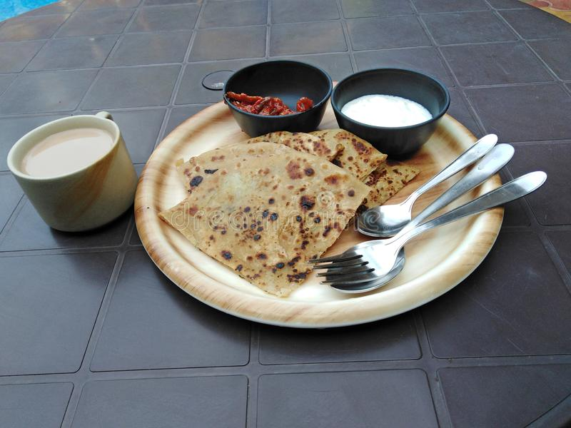 Indian bread with spiced sausse and masala tea. Goa royalty free stock image