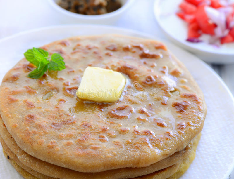 Indian breakfast- aloo paratha. Aloo paratha- Indian potato pancakes served with yogurt dip royalty free stock photo