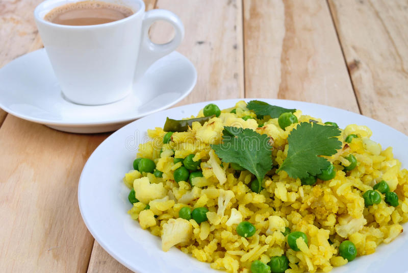 Indian breakfast Poha. Served with Tea royalty free stock photography
