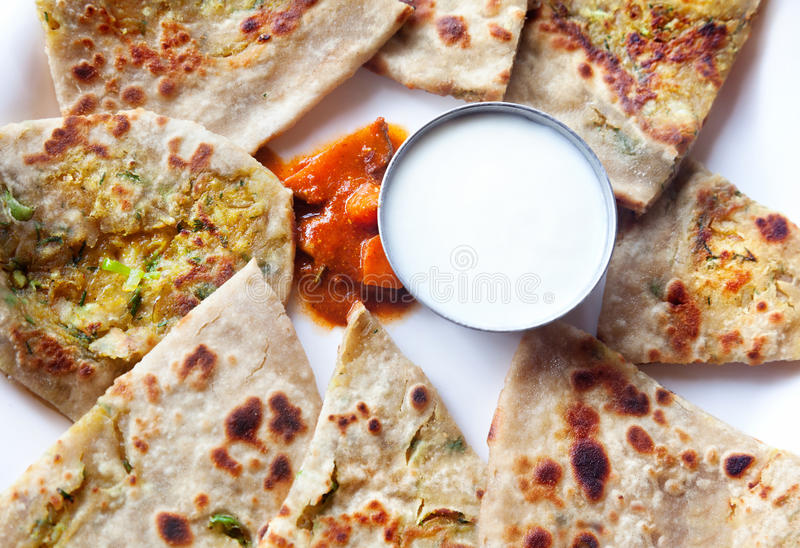 Indian breakfast. Vegetarian aloo paratha with curd and mango pickle in Indian restaurant stock photography