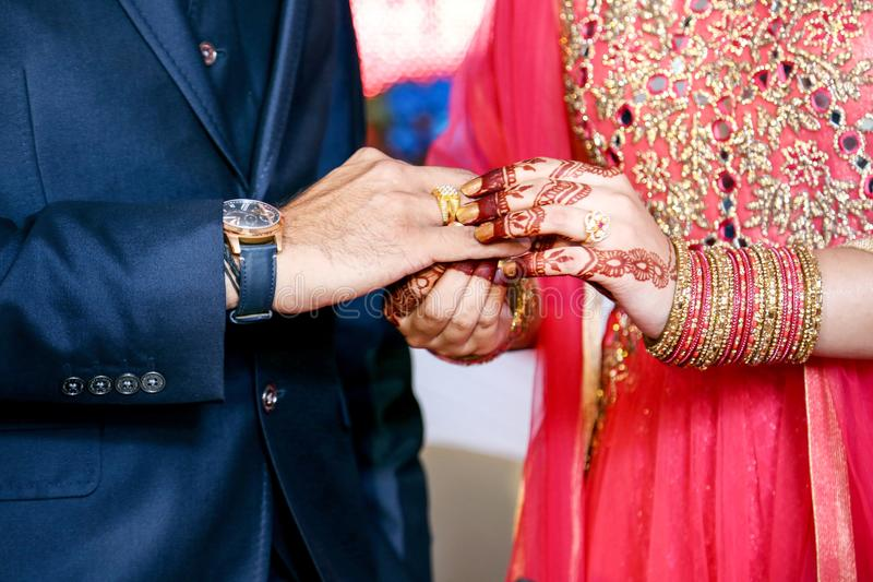 Indian Bride putting ring on indian Groom royalty free stock images