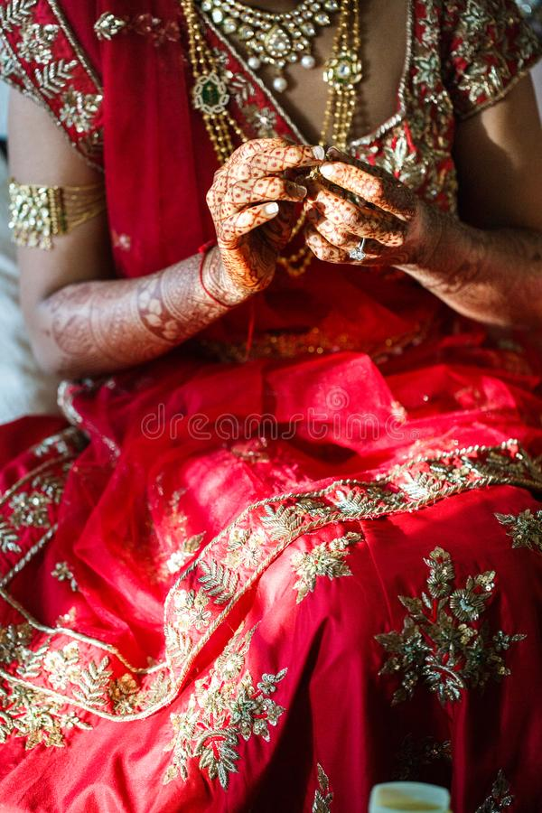 Indian bride wears jewelry on her wedding day royalty free stock image