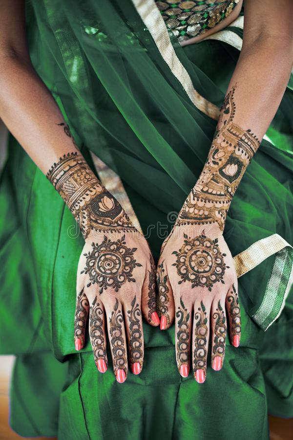 Indian bride showing menhdi henna tattoo on back hand, Close-up stock photos