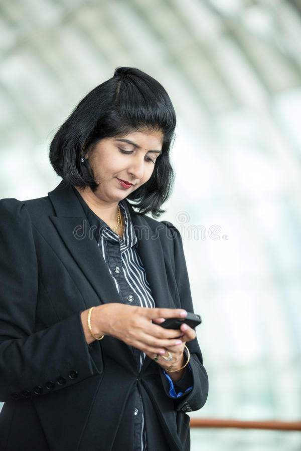 Download Indian Business Woman Using Mobile Phone. Royalty Free Stock Photos - Image: 25958858