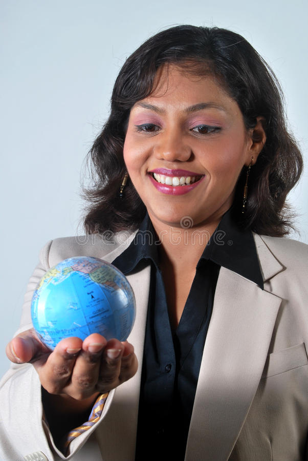 Download Indian Business Woman With The World In Her Hands Stock Photo - Image of businesswoman, confident: 16728442