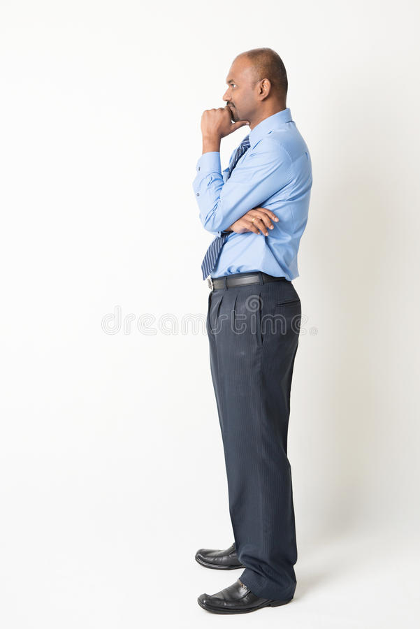 Indian businessman having a thought stock photography