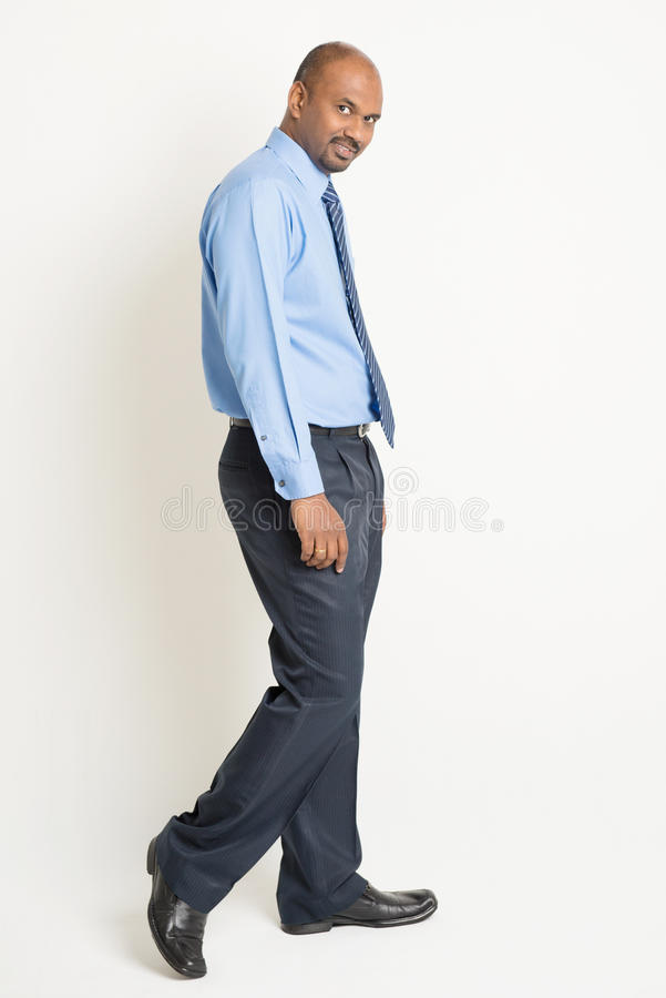 Indian businessman walking royalty free stock photos