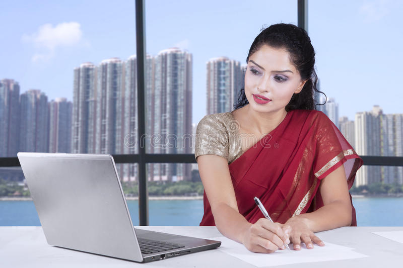 Indian businesswoman with sari in office royalty free stock photos