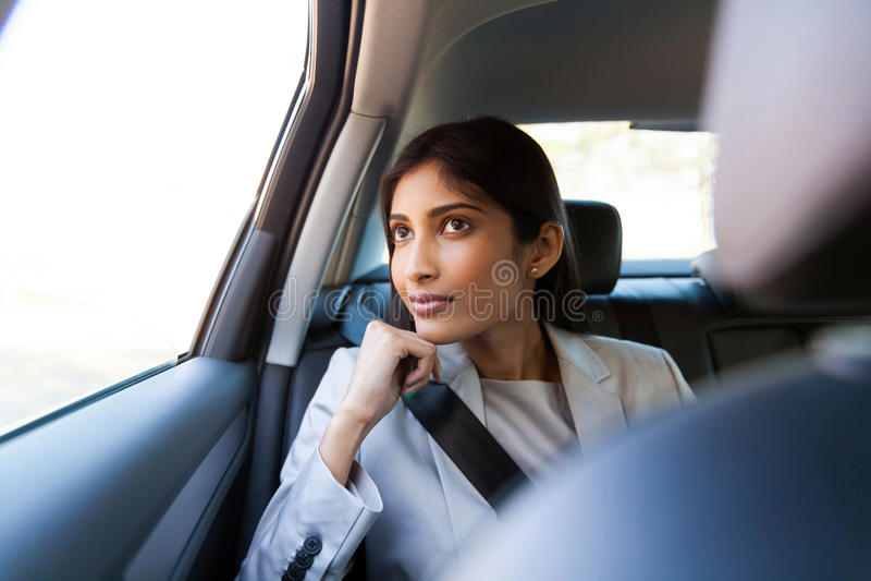 Indian businesswoman sitting car royalty free stock photos