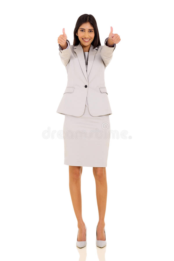 Indian businesswoman thumbs up. Cheerful indian businesswoman giving thumbs up on white background royalty free stock images