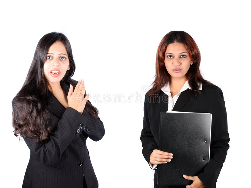 Indian Businesswomen. A team of Indian businesswomen explaining their product, on white studio background royalty free stock photography