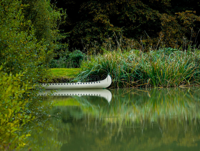 Indian Canoe on the lake. Taken at Deadwood in Horsham - a cowboy & Indian town with population of 157 people royalty free stock photos