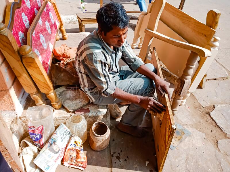 An indian carpenter making bedroom furniture at outside of the workshop in india January 2020 royalty free stock images