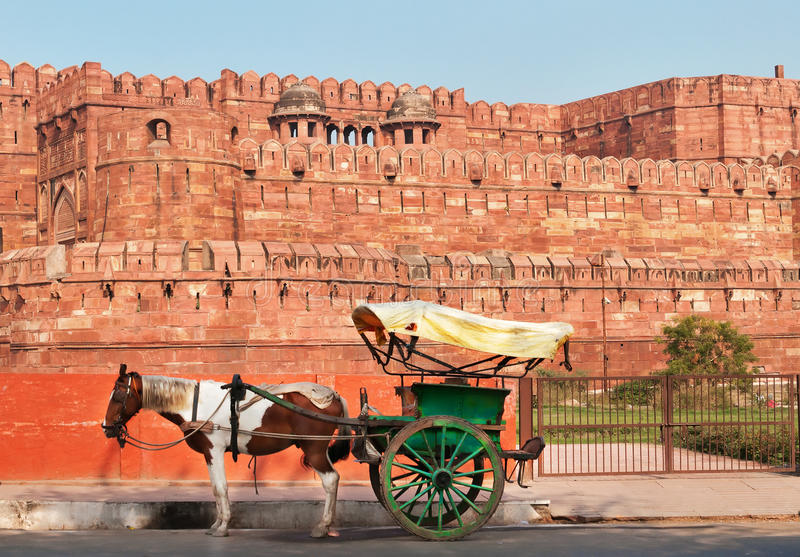 Indian carriage with horse is waiting of passengers at the entrance to Agra Fort royalty free stock images
