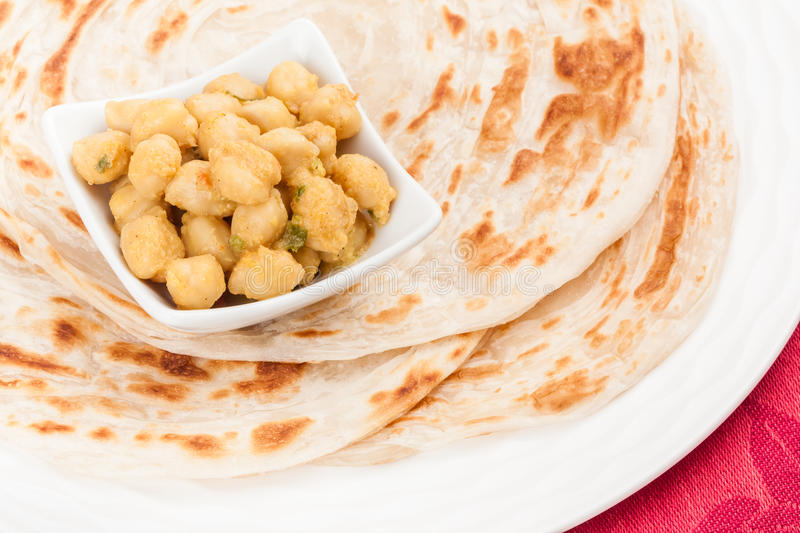 Indian Chana Masala and Parotta. Homemade parotta (Indian bread) served with delicious Indian chana masala. It is prepared using chana dal (chickpea) and various royalty free stock images