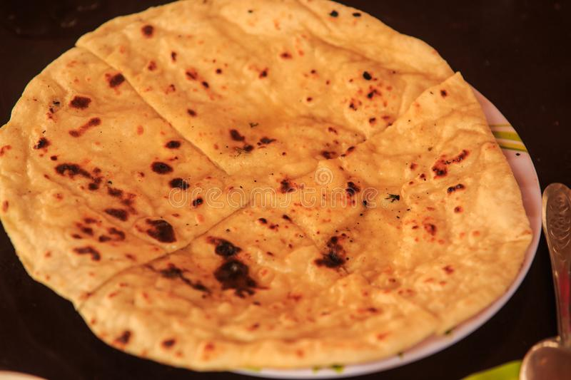 Indian Cheese Stuffed Naan Bread on Black Background stock photos