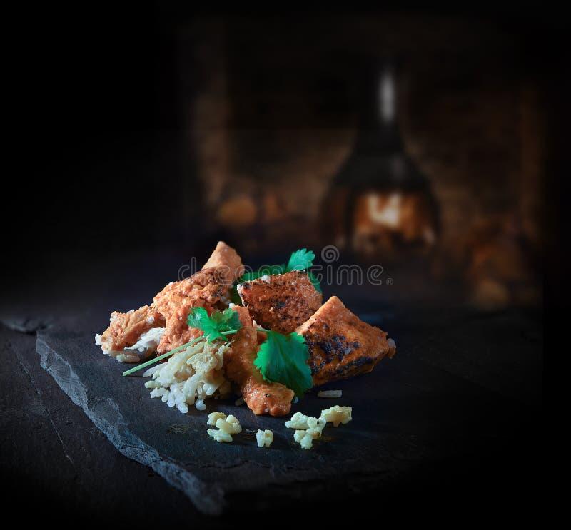 Indian Chicken Biryani  II. Authentic Indian Chicken Biryani dish, cooked in traditional Tandoori methods with basmati rice and coriander cilantro garnish. Shot stock photos