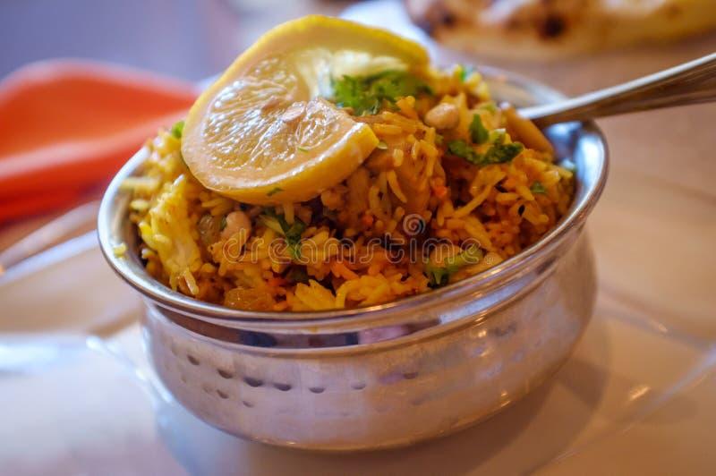 Indian Chicken Biryani Rice. Spicy Indian chicken biryani rice in metal bowl stock photo