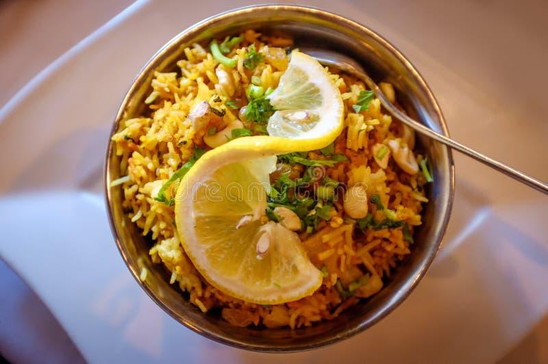Indian Chicken Biryani Rice. Spicy Indian chicken biryani rice in metal bowl royalty free stock photography
