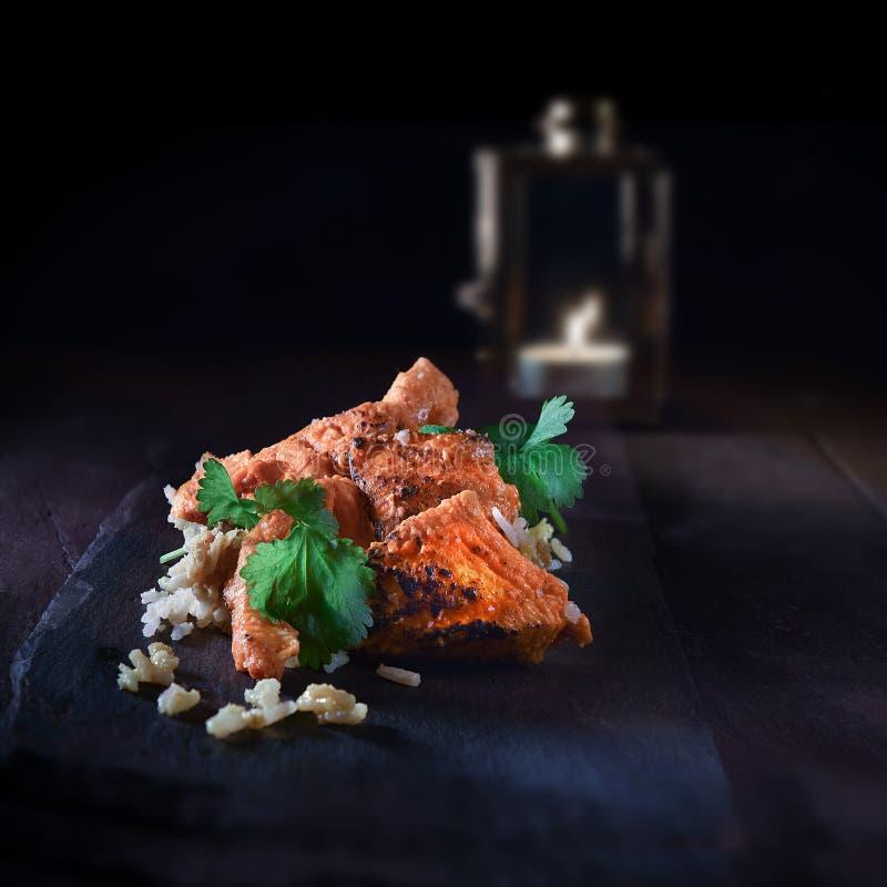 Indian Chicken Byriani. Authentic Indian Chicken Biryani dish, cooked in traditional Tandoori methods with basmati rice and coriander cilantro garnish. Shot stock image