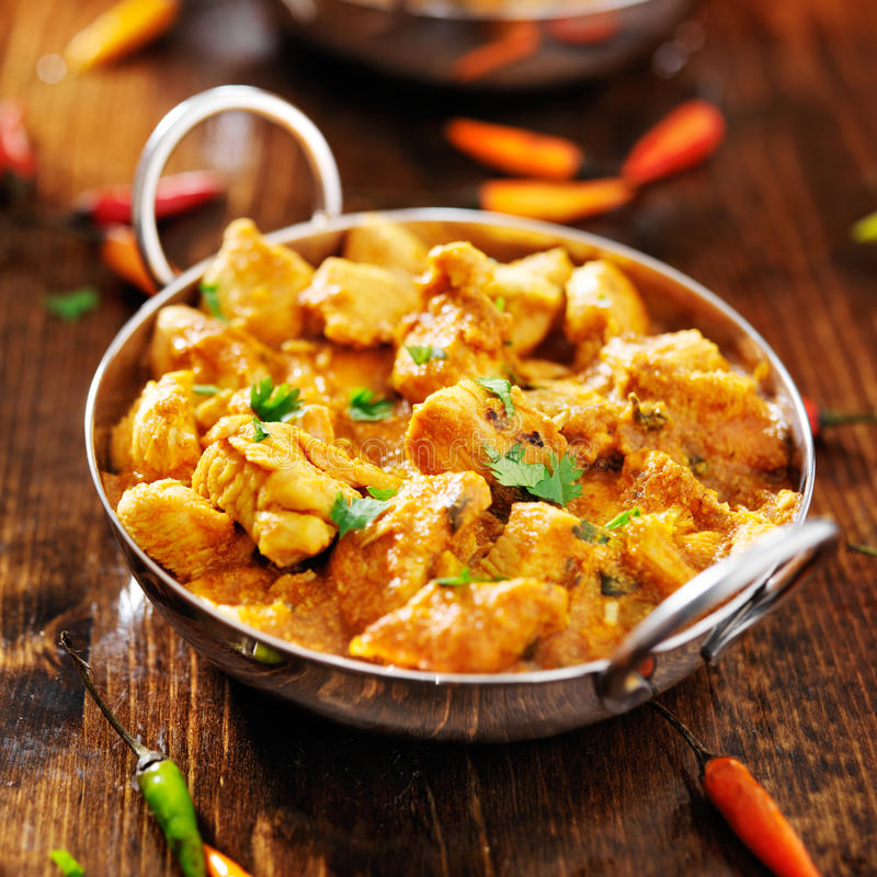 Indian chicken curry in balti dish. With chopped cilantro leaves stock image