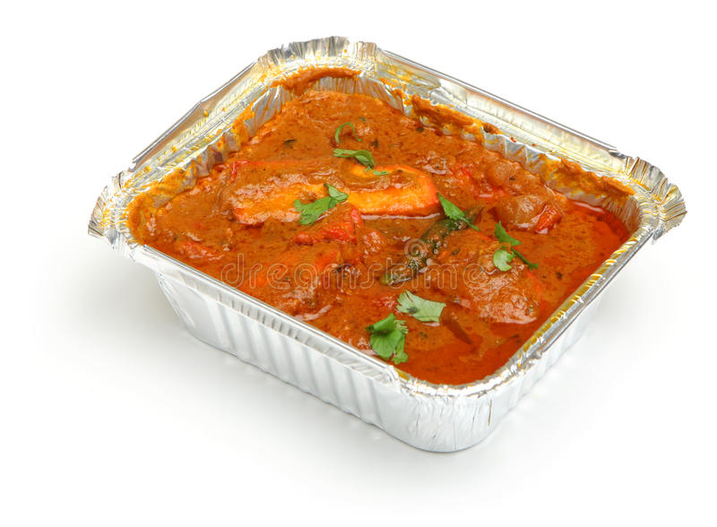 Indian Chicken Curry Food Takeaway. Indian chicken curry in takeaway container stock photography