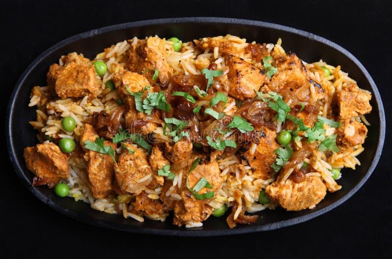 Indian Chicken Tikka Biriyani. In a cast iron sizzler dish royalty free stock photography