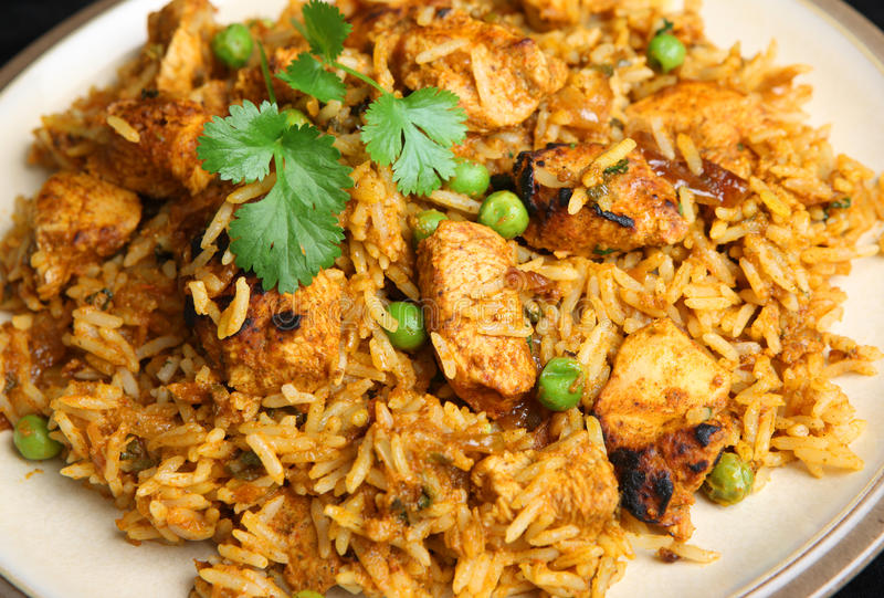 Indian Chicken Tikka Biriyani Curry Dinner. Indian chicken tikka biriyani curry stock photos