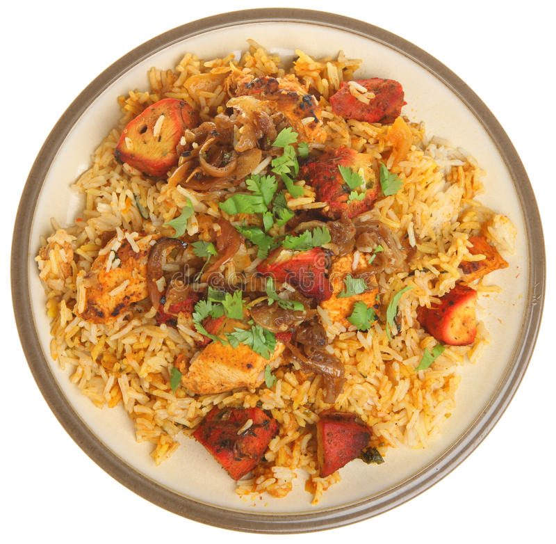 Indian Chicken Tikka Biriyani Curry. Isolated on white stock photos