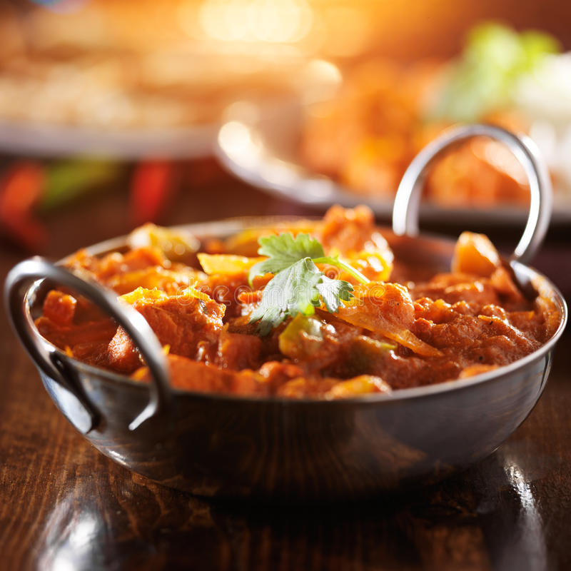 Indian chicken vindaloo curry in balti dish. With lens flare royalty free stock image