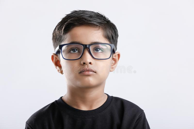 Indian child wearing spectacles and looking seriously royalty free stock image
