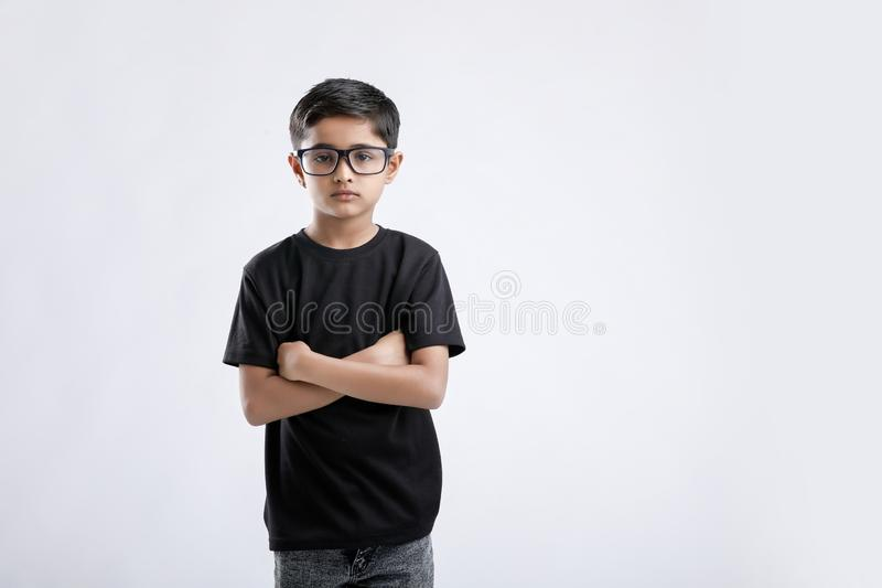 Indian child wearing spectacles and looking seriously stock image