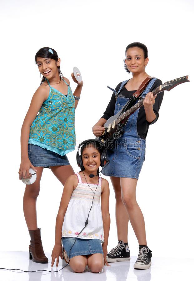 Indian Children music band. Indian girls music band over white background stock photos