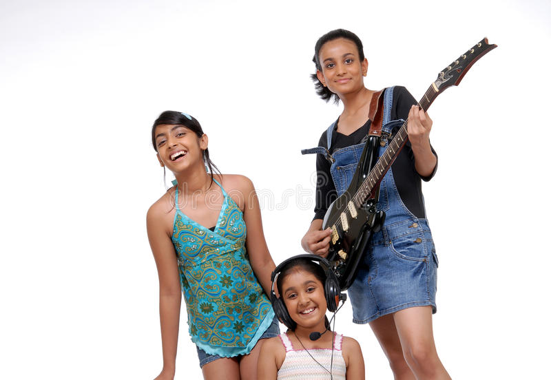 Indian Children music band. Indian girls music band over white background stock photography